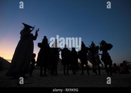 Himba and herero women dance together - Stock Photo