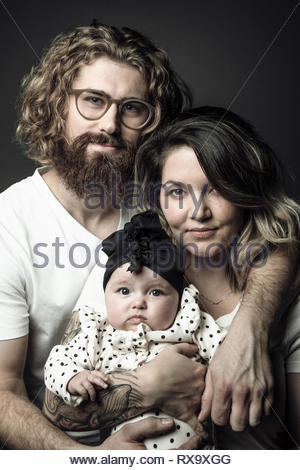 Portrait couple with baby daughter - Stock Photo