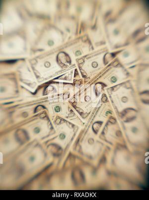 Money displayed on table as if looked through an addicts mind and hallucinating - Stock Photo