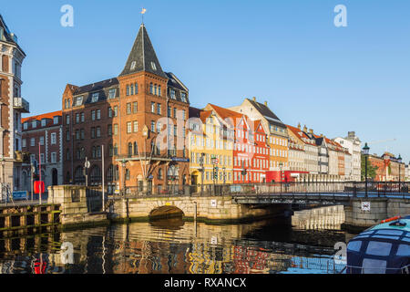Canal bridge with view of  Somandshjem hotel and colourful 17th century apartment buildings along the Nyhavn canal, Copenhagen, Denmark, Europe - Stock Photo