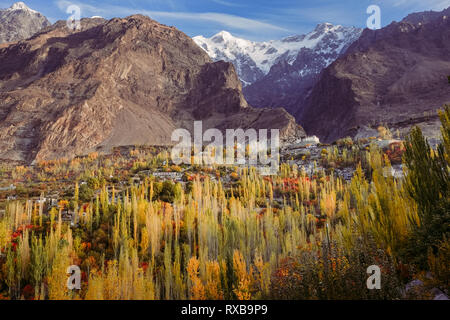 Landscape autumn in Hunza valley. Beautiful scenery of Baltit fort and snow capped Ultar Sar mountain in Karakoram range. Gilgit Baltistan, Pakistan. - Stock Photo