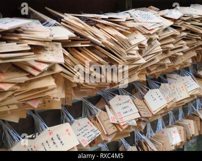 Nara, Japan - 15 Oct 2018: Prayers and good wishes written on wooden boards at a temple near the Kasuga Grand Shrine at Nara, Japan - Stock Photo
