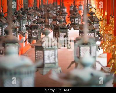 Nara, Japan - 15 Oct 2018: A row of lanterns at a temple near the Kasuga Grand Shrine at Nara, Japan - Stock Photo