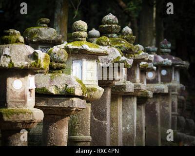 Nara, Japan - 15 Oct 2018: A row of weathered ancient stone structures near the Kasuga Grand Shrine at Nara, Japan - Stock Photo