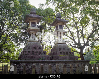 Nara, Japan - 15 Oct 2018: Ancient mossy stone structures near the Kasuga Grand Shrine at Nara, Japan - Stock Photo