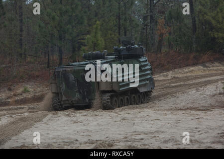 U.S. Marines with 2nd Assault Amphibian Battalion, 2nd Marine Division, operate an Amphibious Assault Vehicle-7 while participating in a Mechanized Assault on Camp Lejeune, N.C., Mar. 6, 2019. This training incorporates multiple combat elements to maintain mission readiness and enhance operational effectiveness. (U.S. Marine Corps photo by Lance Cpl. Nathaniel Q. Hamilton) - Stock Photo