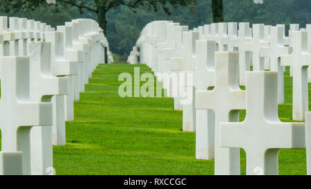 Hundreds of white crosses on the cemetery in Normandy. The bodies of the american people who died dduring the WWII - Stock Photo