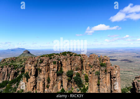 Sunny South Africa Graaff-Reinet,Valley of Desolation, Karoo, Camdeboo, panorama,impressive bizarre rocks under blue sky with some clouds, mountains - Stock Photo