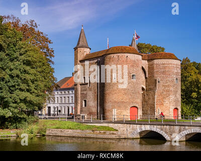 25 September 2018: Bruges, Belgium - The Gentpoort or Ghent Gate, a 15th Century part of the city's defences. - Stock Photo