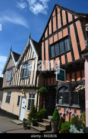 Historic Tudor half-timbered buildings and shops in the High Street Lavenham, Suffolk, UK. Sunny day. - Stock Photo