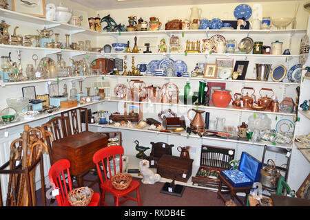 Inside an antique and curiosities shop in Lavenham, Suffolk, UK. Sunny day. - Stock Photo