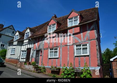 Historic Tudor half-timbered buildings in Lavenham, Suffolk, UK. Sunny day. - Stock Photo