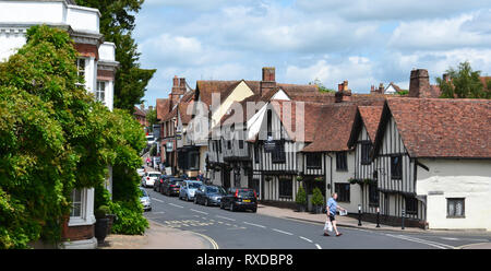 Historic Tudor half-timbered buildings in Lavenham High Street, Suffolk, UK. Sunny day. - Stock Photo