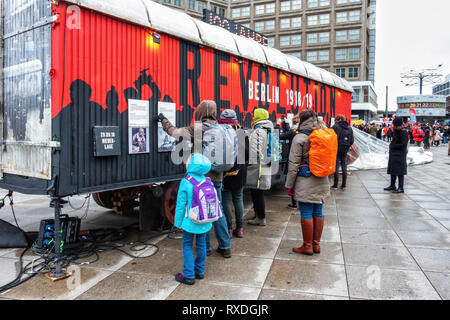 Berlin, Germany. 8th Mar 2019.  Exhibition celebrating 100 years of Revolution 1918-1919 using placards, information towers and a mobile furniture van to document historical events. During the November revolution furniture vans were used as barricades and a historic furniture van is a central element of this winter exhibition theme that documents the event. November 2018 marked the 100th anniversary of the end of the First World War and the November Revolution. Credit: Eden Breitz/Alamy Live News - Stock Photo