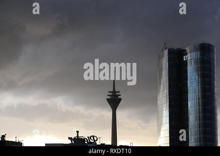 09 March 2019, North Rhine-Westphalia, Düsseldorf: Dark clouds are moving over the TV tower and the GAP 15 high-rise. Storm gusts and thunderstorms on Saturday afternoon in North Rhine-Westphalia caused problems in rail traffic and on the roads at Sturmtief Dragi. (to dpa 'Storm causes train cancellations in the Ruhr area - Autobahn 40 flooded') Photo: Marc Herwig/dpa - Stock Photo