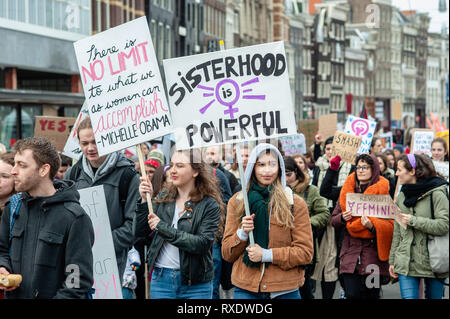 Amsterdam, North Holland, Netherlands. 9th Mar, 2019. A group of women are seen holding placards during the demonstration.A day after the International Women's day a demonstration under the motto 'all oppression is connected', took place at the center of Amsterdam. Hundreds of people gathered at the Dam square to make a statement for their rights to be who they are, including living without fear, with respect, equal pay and having the same right to justice regardless of skin colour, income, religion or ability. Credit: Ana Fernandez/SOPA Images/ZUMA Wire/Alamy Live News - Stock Photo