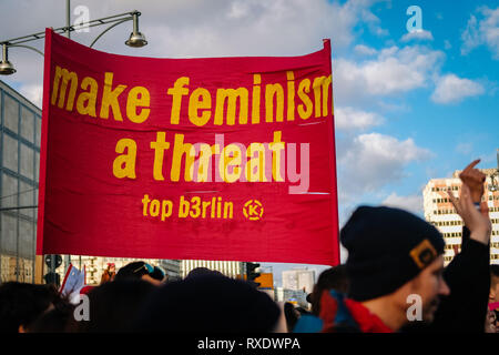 Berlin, Berlin, Germany. 8th Mar, 2019. A protester seen holding a placards saying Make feminism a threat during the protest.Thousands of people celebrate the international women´s day with protests demanding for women rights in berlin. Credit: Lorena De La Cuesta/SOPA Images/ZUMA Wire/Alamy Live News - Stock Photo