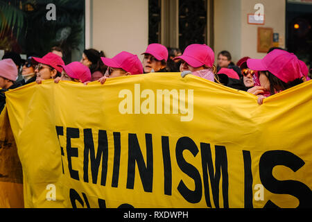 Berlin, Berlin, Germany. 8th Mar, 2019. Women wearing pink caps are seen holding a banner during the protest.Thousands of people celebrate the international women´s day with protests demanding for women rights in berlin. Credit: Lorena De La Cuesta/SOPA Images/ZUMA Wire/Alamy Live News - Stock Photo