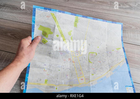 the consultation of the city map of Lisbon - Stock Photo
