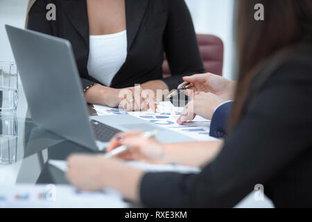 close up. business team analyzes financial data - Stock Photo