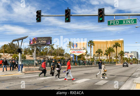 LAS VEGAS, NV, USA - FEBRUARY 2019: People queuing to have their picture taken in front of the famous 'Welcome to Las Vegas' sign. The sign is at the  - Stock Photo