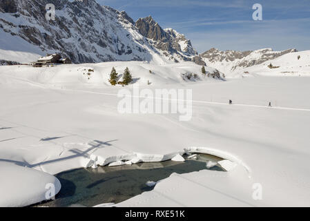 Engelberg, Switzerland - 3 March 2019: People walking at Trubsee over Engelberg on the Swiss alps - Stock Photo