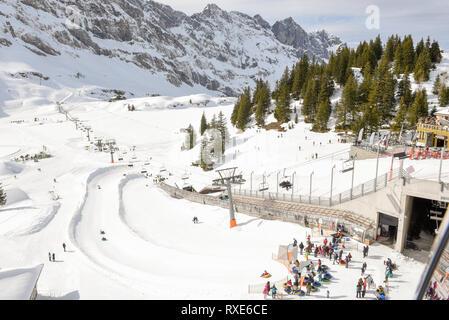 Engelberg, Switzerland - 3 March 2019: people snow tubing over Engelberg on the Swiss alps - Stock Photo