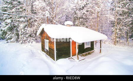 Rotating view of the house covered in snow in the winter season in Scandinavia - Stock Photo