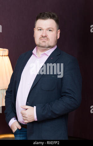 Male 45 years old with obesity on a dark background. - Stock Photo