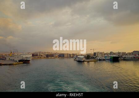 Piraeus Harbour : March 3rd. Commercial ferry boat  Blue Star Paros leaving harbour early in the morning destination Syros Island. - Stock Photo