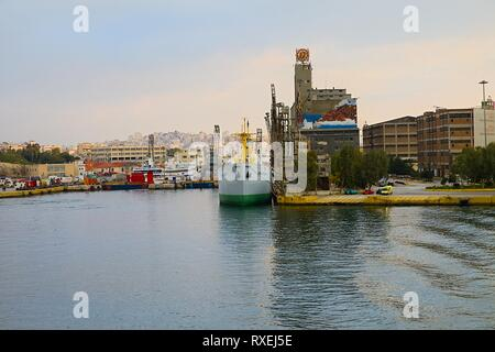 Piraeus Harbour : March 3rd. Commercial ferry boat  Blue Star Paros leaving harbour early in the morning destination Syros Island. March 3rd, 2019 - Stock Photo