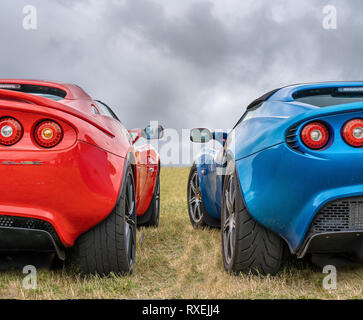 BOSSCHENHOOFD/NETHERLANDS-JUNE 17, 2018: back view of two classic blue and red Lotus Elise at a classic car meeting - Stock Photo
