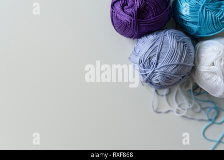 View from above on colorful yarn balls for hand knitting isolated on white table background. - Stock Photo