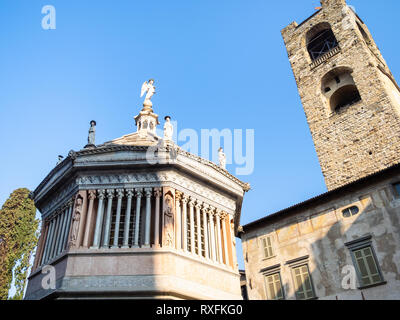 Travel to Italy - view of Baptistery and Campanone (Torre civica) bell tower from Piazza Duomo square in Citta Alta (Upper Town) of Bergamo city, Lomb - Stock Photo