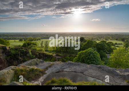 The view across the Lancashire countryside towards the Fylde coast from Denham quarry near Chorley - Stock Photo