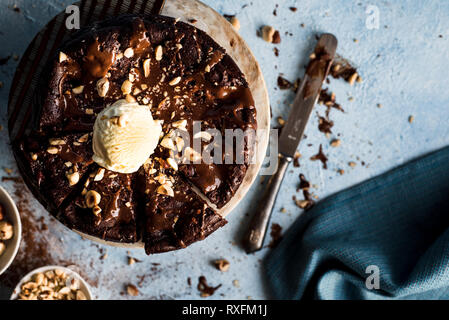 Chocolate cake with a scoop of vanilla ice cream - Stock Photo
