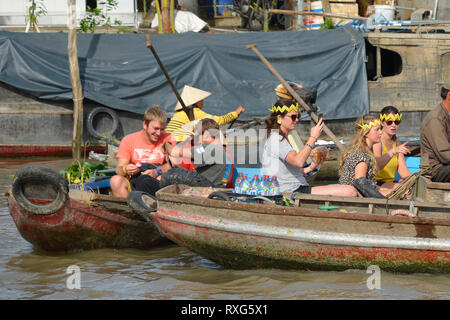 Phong Dien, Vietnam - December 31st 2017. Tourist on a boat tour at the Phong Dien Floating Market near Can Tho in the Mekong Delta - Stock Photo