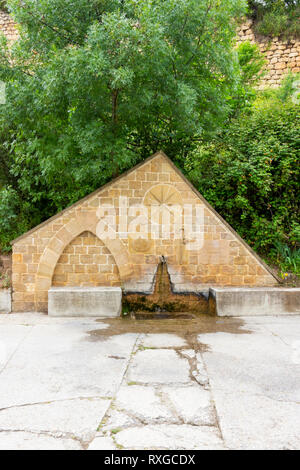 A pilgrim fountain in Estella or Lizzara, Navarre Spain, Calle Curtidores or Curtidores Street on the Way of St. James, Camino de Santiago - Stock Photo