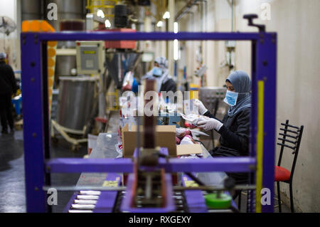 Palestinian Women Are Seen Working At A Coffee Factory In