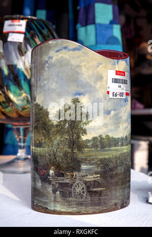 A vase featuring The Hay Wain by John Constable in the window of a Shelter charity shop in Edinburgh, Scotland, UK.