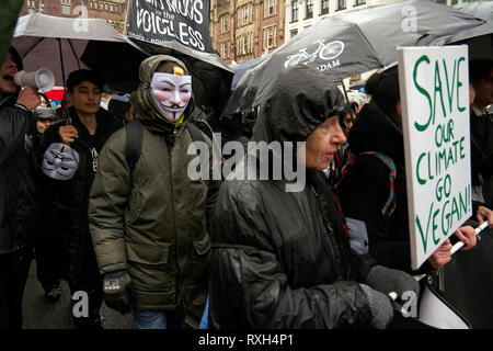 Movements like Anonymous also participate in the march against climate change. Summoned by civil associations and NGOs, thousands of people demonstrated today in Amsterdam to demand that governments act decisively in the face of the increasingly imminent danger posed by climate change. - Stock Photo