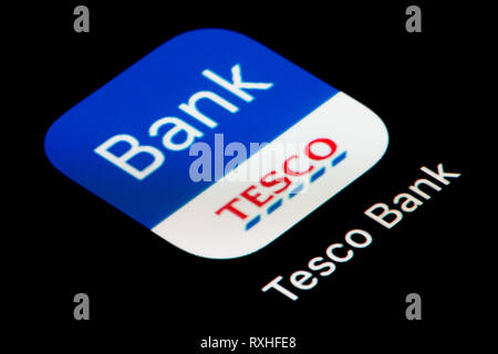 A close-up shot of the Tesco Bank app icon, as seen on the screen of a smart phone (Editorial use only) - Stock Photo
