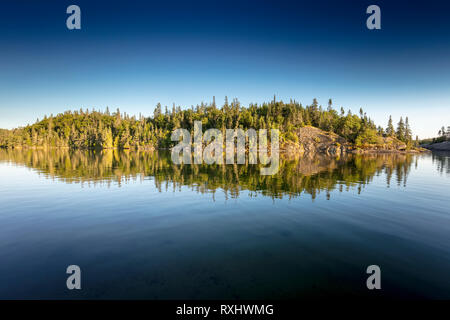 Boreal forest on rocky cliffs in Hattie Cove, Pukaskwa National Park, Ontario, Canada - Stock Photo