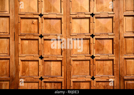 Sunlit wooden doors, square patterns with natural grains and textures. - Stock Photo
