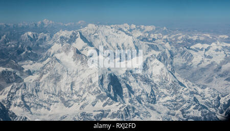 Aerial view of the Himalaya mountains, taken from the flight between Kathmandu in Nepal and Lhasa in Tibet. - Stock Photo
