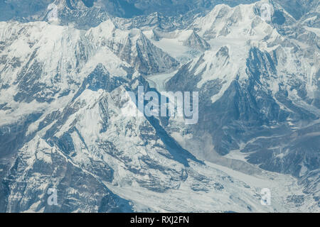 View of Mount Everest and surrounding mountains and snow covered landscape, on the flight from Lhasa, Tibet to Kathmandu, Nepal. - Stock Photo