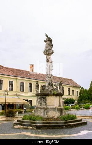 Holy Trinity sculpture. Holy Trinity Column. Plague Column on main square in historical town Koszeg. Hungary. - Stock Photo