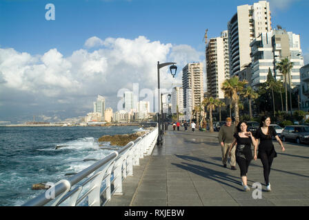 Beirut's Corniche, a spacious palm fringed boardwalk that hugs the sides of the Mediterranean. All of Beirut's denizens come to promenade in the after - Stock Photo