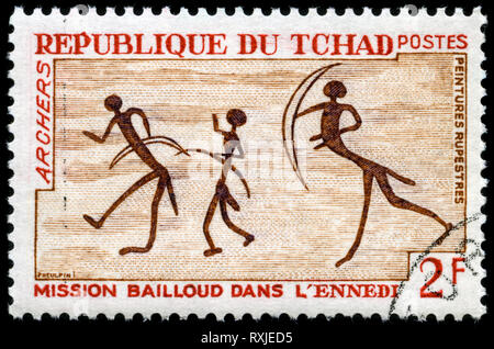 Postage stamp from Chad in the Rock Art from the Ennedi Mountains series issued in 1968 - Stock Photo
