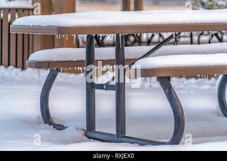 Snow covered table with seats in Eagle Mountain - Stock Photo